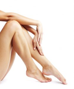 Portrait image of beautiful legs and hands of woman
