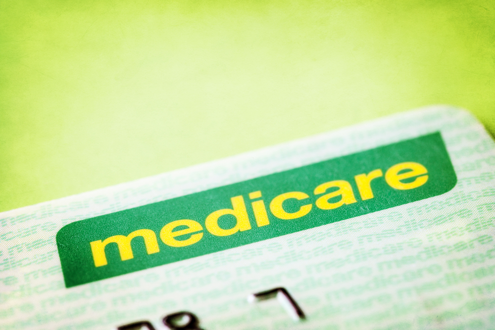 Green Medicare card with light green background.
